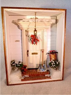 Miniature 8 1/2 x 11 room box depicting a front  door decorated for Christmas by Minidecorandmore