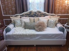 I created this space for Home Made Simple on the OWN Network. I took a headboard and paired it up with a queen mattress to create a French inspired daybed. For more information go to www.homemadesimple.com