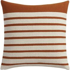 """Shop division rust 20"""" pillow.   Upcycled yarn spins a fresh color story in a nubby, earthy weave of rust/natural stripes.  Wide rust border on one end keeps things unpredictable.  Cotton/acrylic pillow flips to 100% cotton in natural."""