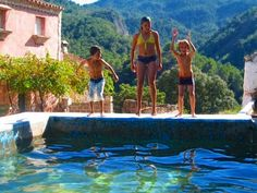 The kids jumping into the fresh spring water at the El Convento yoga retreat