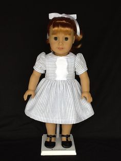 18 inch doll dress .  Fits American Girl Dolls. Blue and white seersucker with white contrast.