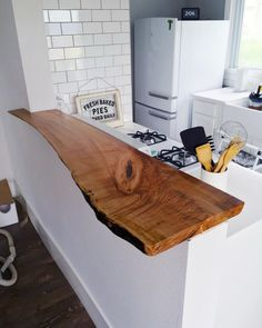 Nothing brings an organic touch to a kitchen like a live edge wood countertop. Since these can be pricey, consider a smaller section of countertop like a raised bar, instead of a full kitchen.