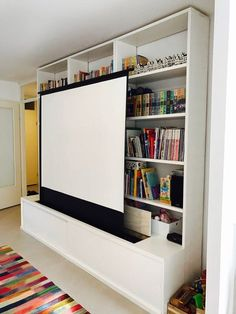 """Later on we added an adjusting cupboard built-in to host a projector screen inside as a part of our home cinema."""
