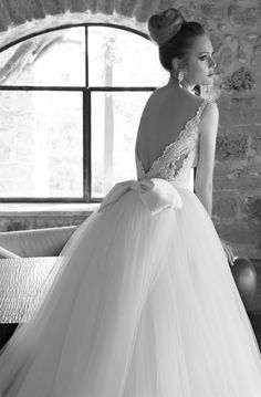Emanuel Haute Couture wedding dress with bow from the 2013 Collection.