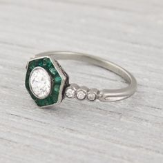 Vintage .50 Carat Diamond and Emerald Engagement Ring.