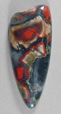 cabochon of tabu tabu, also sometimes called 'smoke and embers' jasper, or forest fire jasper, from Africa. Silverhawk's Designer Gemstones