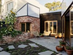 Sustainable Heritage Home Renovation: Brick and timber wood clad exterior and patio of a sustainable family home Renovations, House Exterior, Exposed Brick, Melbourne House, Exterior Decor, House, Stunning Interiors, Australian Architecture, Pale Wood