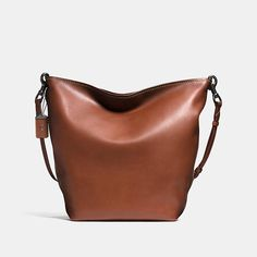 An iconic silhouette from the 1970s, the Duffle bag is reimagined for the modern man. Crafted in burnished, very natural glovetanned leather, the slouchy shape features multifunctional pockets, zip-top closure and a detachable crossbody strap.