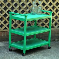 This fun vintage cart has been painted spring green and pale blue, then antique glazed and distressed for a shabby chic appeal. The trays are stained and worn a little more than the frame for a little contrast.  We see this three shelved cart as being so useful in the kitchen or laundry room for extra storage. You can also use for as a serving cart for meals or parties.