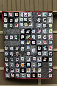 """Polaroids quitl   Process:  I sent them each 9 Polaroid blocks + 2 1/2"""" strips of at least three black or black & white fabrics. I asked that they 'frame' each Polaroid block and then create one large block with them all."""