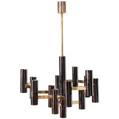 Sciolari Style Black and Brass Multi Chandelier | From a unique collection of antique and modern chandeliers and pendants at https://www.1stdibs.com/furniture/lighting/chandeliers-pendant-lights/