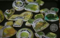green and gold watercolor custom cookies