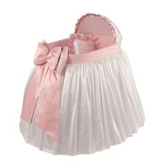 The Serendipity Bassinet is a great gift for that special little girl. It is dressed in a white skirt adorned with a pink damask fabric and