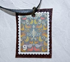 No. 9 Floral Doves on Etsy, $10.00 The No. 9 Floral Doves is a part of our Bijoux Stamp Collection.    Floral Doves stamp.      Matted on brown leather.    Copper platted metal link.  #gift #shopping #steampunk