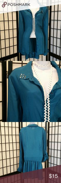 Xhilaration Hi-Low Teal Green Blouse Gorgeous, Plus Size 3, Excellent Condition, Accessories not included, Stud Flat Collar, Button Down, Can be Worn Long Sleeve or Button Fold Up, 1 Front Pocket, Ruffle Sheer in Back, Lightning is off its not blue, but teal Green. Thanks for sharing my closet, I will ALWAYS show Posh love by doing the same. Xhilaration Tops Button Down Shirts