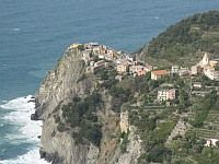Top Ten Places to Visit in Italy  | Shown -  Ligurian Coast - Cinque Terra  Five towns located on cliffs overlooking the ocean, Cinque Terra is simply breathtaking. Spend the day walking the 12km trail that connects each town, exploring there tiny streets, and stopping at little cafes. Explore the olive groves in the hills and relax yourself with a shot of Limoncello.  http://www.hotelclub.com/blog/top-ten-places-to-visit-in-italy/