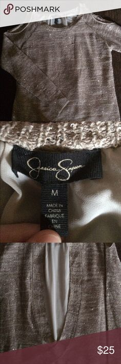 Cute and Sparkly Jessica Simpson Cut-out Top Very cute and wearable for any season any time! Genuine Jessica Simpson so price is a bit firm. I've only worn it once so the tags are off but it has no faults at all. Happy Shopping! Jessica Simpson Tops Blouses