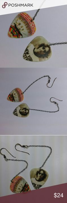 The Beatles Guitar  Pick Earings John Lennon on one.  And Magic Mystery Tour on the other. Fun! Not meant to match both ears Same image on front and back of each one Quality sterling Silver posts. Some tarnish but I got this...thanx Unusual and uniquely yours. Price firm. Jewelry Earrings