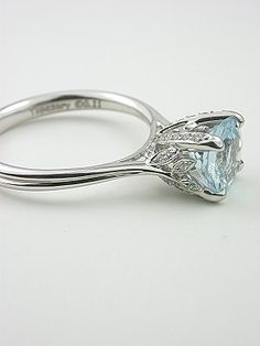 *gasp* gorgeous- very whimsical setting----------- I hate rings with raised gems but this is very pretty indeed.