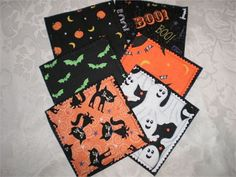 This set of six handmade coasters is made of six different Halloween printed fabrics featuring black cats, ghosts, bats, pumpkins and moons.  The back side is a black upcycled polyester felt made of recycled plastic bottles.   Use it to make a garland, decorate a classroom or add it to any of your Halloween home decor. This set of coasters makes a perfect thank you gift or a last minute hostess gift.   Size approximately : 4 3/4 inches square.   The coasters are machine sewn and quilted ...