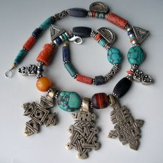 Designer unknown | Vintage wound coral glass beads from the African trade, turquoise, lapis, old Egyptian amber bead, old silver telsum and coptic crosses (silver or a high grade alloy) combined with 925 Balli beads and dangles.