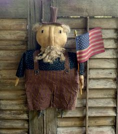 Primitive Uncle Sam Doll w/ Flag - grungy Americana July 4th prim summer - Extreme primitive Americana decor by FolkArtandPrimitives on Etsy https://www.etsy.com/listing/234221902/primitive-uncle-sam-doll-w-flag-grungy