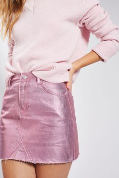 Add an eye-catching sheen to your look with this pink metallic mini skirt. In a classic cut, it sits above the knees and is finished with a cool raw hemline.  #Topshop