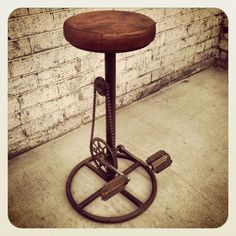 Industrial Bicycle Stool | from Holy Funk.  Retro industrial bicycle stool is designed with a fantastic tanned brown leather seat, recycled bicycle pedals and of coarse the chain to suit. The bike pedals are fixed in position providing the ultimate footrest (sorry, no work out on this guy). A unique, eye catching piece, this stool has endless character and style. Original design.