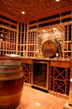 I love the idea of the wine barrel lid coming out from the wall