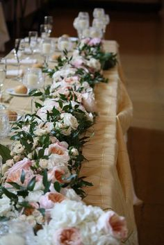 Or in more this style (with ivy)? And of course greenery draping down the front of the table :)