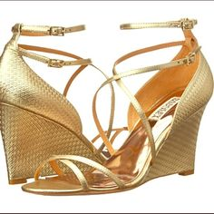 """Badgley Mischka Shoes Put a little shimmer and shine into your day with this stunning Melaney II wedge sandal from Badgley Mischka 3&1/2"""" heel  embossed leather upper delicate criss-cross straps lead to a duel buckle closure at ankle  worn to two weddings  there is a very tiny light smudge on the back of the left shoe shown in the 4th picture which isn't noticeable when wearing. No trades (I don't have the box) Badgley Mischka Shoes"""