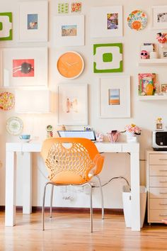 A small spot for a home white Parson's style office desk with a modern orange chair