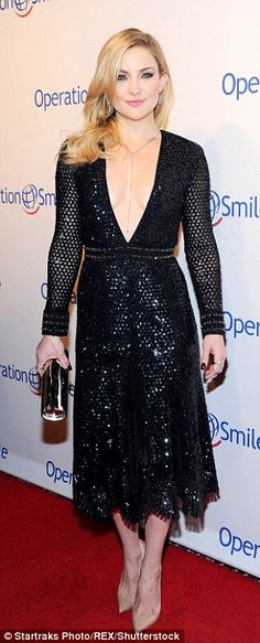 Winning smile! The actress looked flawless on the red carpet in her shimmering dress as she flashed her pearly whites
