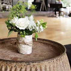 Centerpieces were created using canning jars wrapped with twine in white birch bark that were filled with just picked garden bouquets of flowers. Nice!