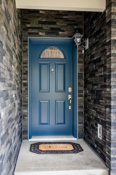 The wraparound stone really complements the color of the front door. Check out more of our beautiful doors in our gallery! #frontdoor #stone #color