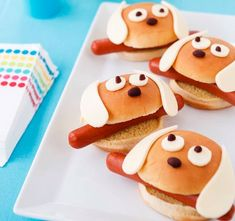 From Family Fun...It's a dog-eat-dog world: slip hot dogs into hamburger buns and attach American cheese eyes and ears and black bean noses with mustard.