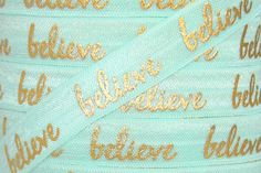 "Aqua/Gold Metallic ""believe"" Print 5/8"" Fold Over Elastic"
