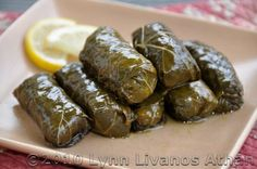 Stuffed Grape Leaves with Rice and Herbs - Dolmathakia.  Classic Greek appetizer.  I usually serve grape leaves with a dish of Tabbouleh; hot, buttered Pita bread; and Apothic Red wine.