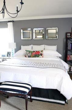 Love this bedroom.  But I (and by I, I mean my husband) could never get away with white bedding!