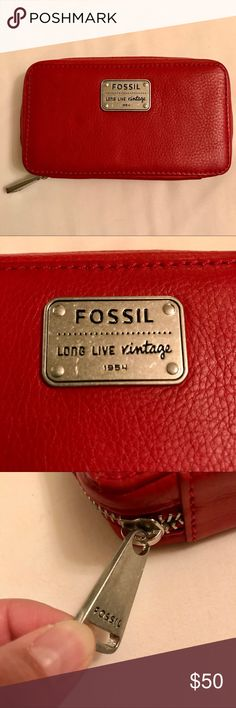 Fossil leather jewelry travel wallet /case Red leather exterior with steel hardware. Textile interior with red key icon embroidered pattern. Has three jewelry pouches and a ring holder. Leather pulls on zippers. Still has original Fossil card but not the original price tag. Never been used.  Outside 3.5x6x1.5 Two interior pouches 3x5 Fossil Bags Travel Bags