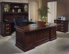 female executive office furniture. it offers an expansive office furniture line in engraved executive mahogany finish. the governors female u
