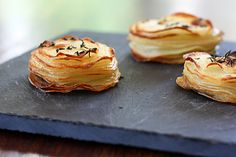 Wow, yum!  Roasted Potato Stacks  Serves 4  INGREDIENTS:  3 tablespoons olive oil  2 cloves garlic, minced  1 lb. Russets potatoes  Salt and pepper  1 tablespoon fresh thyme leaves
