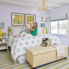 Light fabrics and bright accents give an openness to this bedroom.