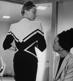 June 1945    Model wearing suit by Adrian for a customer at the Dallas Nieman Marcus.