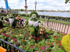 Snow White and the Seven Dwarfs topiaries, located at the Germany Pavilion at the 2015 Epcot International Flower & Garden Festival at Walt Disney World Resort