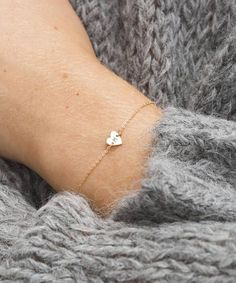 Super Dainty Heart Bracelet in Gold, Silver, or Rose Gold. Add a custom initial or leave it blank! Say hello to the cutest possible bracelet known to man. This super subtle piece is the perfect way to keep your loved ones close to you throughout the day. It also makes a super