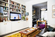 The Wallpaper-Covered Brooklyn Home of Studio Four NYC's Founder Kate Reynolds Brooklyn House Tour: Apartment Bookshelves, Bookshelves With Tv, Brooklyn House, Blue Sectional, Condo Remodel, Big Design, Family Room Design, Paper Houses, Furniture Styles
