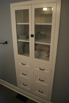 Revamp a linen closet: remove the door & replace with drawers and glass doors.