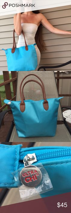 "Bright blue tote with saddle brown handles 💙🌙 This is an amazing alternative to the ""long champ"" tote at a much more affordable price! I've never worn this bag but it does have minor surface markings on front and back very minimal but there are a few marks. It's overall a beautiful bag the inside is flawless and silky and has a side zipper. Please ask any questions photos of the minimal marks will be available upon request 💙 *this is not a long champ bag* tag is only used for exposure…"