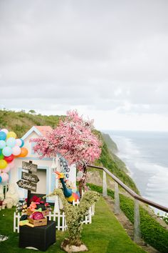 Elaborate photobooth backdrop at a wedding inspired by Disney Pixar's 'Up' // Going 'Up': Richard and Vera's Wedding in Bali